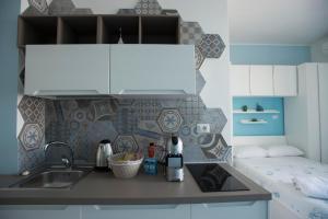 A kitchen or kitchenette at Nereidi Suites