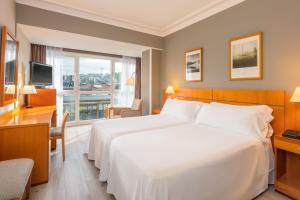 Cama o camas de una habitación en Hotel Tryp San Sebastián Orly