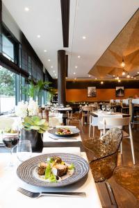 Restaurant ou autre lieu de restauration dans l'établissement Radisson Blu Paris-Boulogne