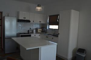 Küche/Küchenzeile in der Unterkunft The Cormorant House
