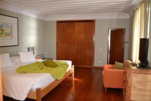 A bed or beds in a room at Pousada de Angra do Heroismo Castelo de S. Sebastiao