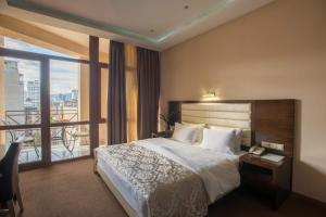 A bed or beds in a room at Hotel Orion Tbilisi