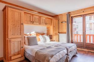 Letto o letti in una camera di Hotel Le Gentiana