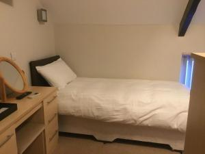 A bed or beds in a room at The Loco