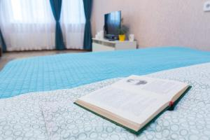 Кровать или кровати в номере Апартаменты - 7 Небо
