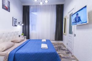 Кровать или кровати в номере ПитерДом Черная Речка
