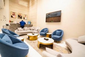 Uma área de estar em Vivian Park Hotel Suites