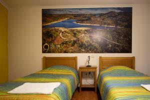 Uma cama ou camas num quarto em Casas do Flor