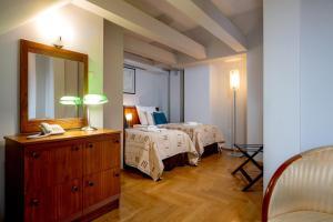 Łóżko lub łóżka w pokoju w obiekcie Red Brick Apartments