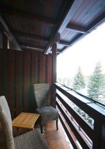 Un balcon sau o terasă la Pensiunea Skiland