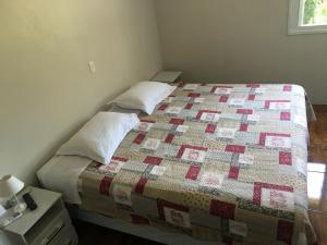 A bed or beds in a room at Pousada Piuco