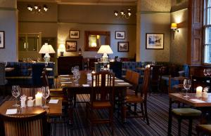 A restaurant or other place to eat at White Hart Hotel by Greene King Inns