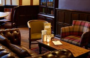 A seating area at White Hart Hotel by Greene King Inns