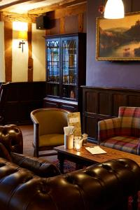 The lounge or bar area at White Hart Hotel by Greene King Inns