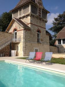 The swimming pool at or near Gîtes Louis de Vauclerc