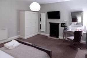 A television and/or entertainment center at The City Rooms