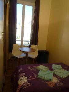 A bed or beds in a room at Hostel Lyonnais