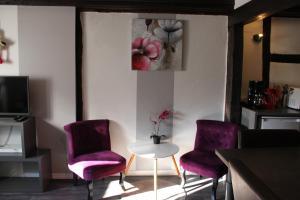 O zonă de relaxare la Appartement les Violettes