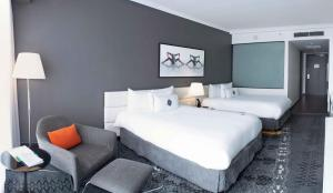 A bed or beds in a room at Sortis Hotel, Spa & Casino, Autograph Collection
