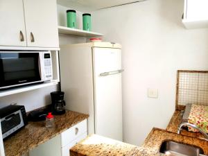 A kitchen or kitchenette at South Beach Copacabana