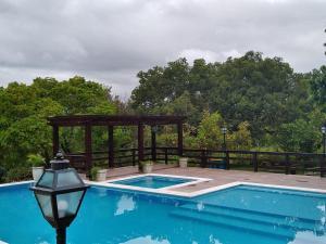 The swimming pool at or near Pousada Portalcion