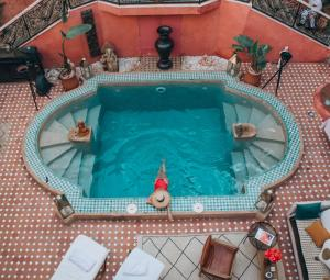 The swimming pool at or near Indian Palace