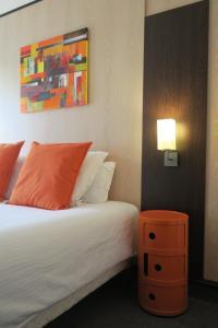 Un ou plusieurs lits dans un hébergement de l'établissement Hôtel Point France