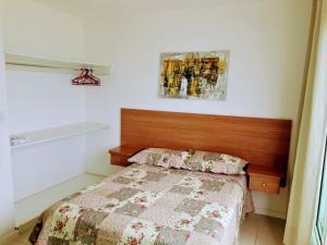 Cama ou camas em um quarto em Casa NA PRAIA do Peró