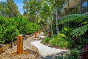 A garden outside Baden 46 - Rainbow Shores, Walk To Beach, Top Floor, Air conditioned Unit, Pools