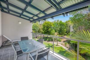 A balcony or terrace at Baden 46 - Rainbow Shores, Walk To Beach, Top Floor, Air conditioned Unit, Pools