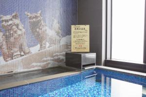 The swimming pool at or near Almont Hotel Naha Kenchomae