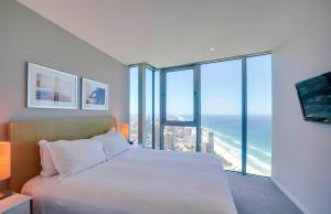 A bed or beds in a room at Hilton Surfers Paradise Hotel & Residences