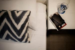 A bed or beds in a room at Ibersol Antemare -Adults Only-