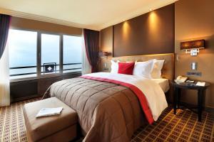 Een bed of bedden in een kamer bij Grand Hotel Huis ter Duin
