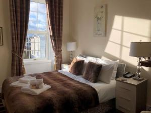 A bed or beds in a room at Haughton Arms Hotel