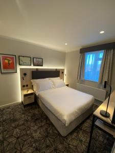 A bed or beds in a room at Highfield House Hotel