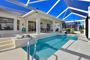 The swimming pool at or close to Serenity On The Water - 3 Bedroom Vacation Home On Marco Island