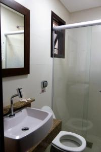 A bathroom at Hotel Costa Dalpiaz