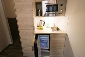 A kitchen or kitchenette at Petul Apart Hotel An'ne 40