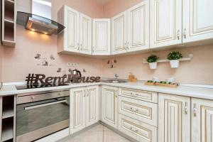 A kitchen or kitchenette at Two Bedroom Apartments Premium Center - Двухкомнатная квартира Центр Премиум НОВАТ, 4 спальных места, RentHouse
