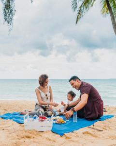 A family staying at Berjaya Tioman Resort