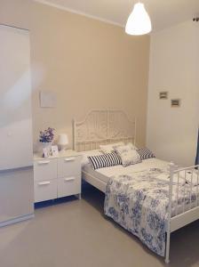 Cama o camas de una habitación en Pensión Cádiz