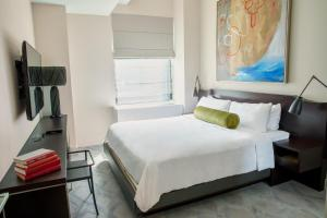 A bed or beds in a room at The Marmara Park Avenue