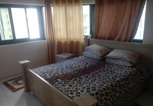 A bed or beds in a room at Al madina Tower
