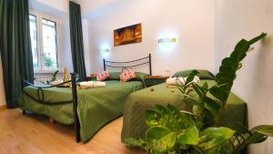 Un ou plusieurs lits dans un hébergement de l'établissement Casa Simpatia Roma - Parcheggio Gratuito a Richiesta - Accettiamo anche Bonus Vacanza Roma !
