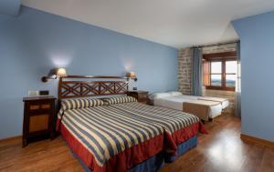 A bed or beds in a room at Palacio de Pujadas by MIJ