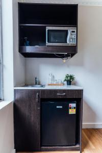 A television and/or entertainment center at UNO Hotel Sydney