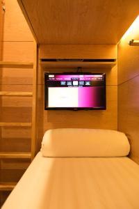 TV/trung tâm giải trí tại VATC Sleep Pod Terminal 1