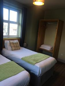 A bed or beds in a room at The Valley Hotel, Anglesey