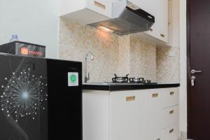 A kitchen or kitchenette at Clean Studio Apartment at Grand Dhika City By Travelio